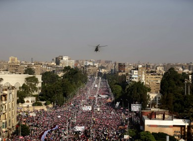 A military helicopter files over the presidential palace as opponents of Egypt's Islamist President Mohammed Morsi protest in Cairo, Egypt today.
