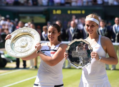 Marion Bartoli (left) poses with her trophy beside Sabine Lisicki, who shows off the runners-up plate.