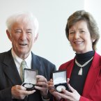 Former President Mary Robinson presents Heaney with the Willie Bermingham medal on behalf of ALONE in 2010.<span class=