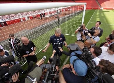 Arsenal manager Arsene Wenger with referee Anthony Taylor during a Goal Line Technology presentation at the Emirates Stadium today.