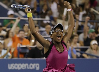Victoria Duval, of the United States, raises her arms in celebration after defeating Australia's Samantha Stosur.