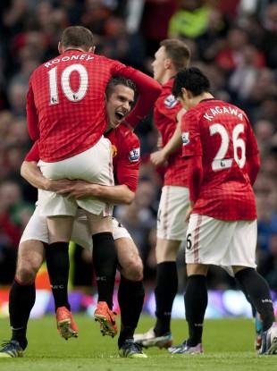 Robin van Persie and Wayne Rooney celebrate at Old Trafford.