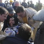 Russia's space agency ground personnel help U.S. astronaut Chris Cassidy, center, shortly after landing.<span class=