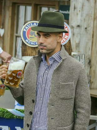 Guardiola enjoys a beer with his team.