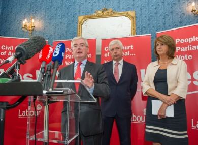 Eamon Gilmore flanked by Alex White and Joan Burton