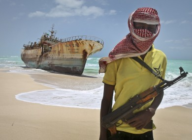 FILE photo of a Somali pirate pictured next to a Taiwanese fishing vessel last year.