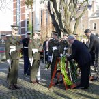 Eamon Gilmore and Charge d'affaires Stuart Dwyer pictured at a wreath laying ceremony at the US Embassy in Dublin. <span class=