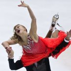 Russia's Ekaterina Bobrova and Dmitri Soloviev perform in the ice dance short dance program at the Cup of China Grand Prix of Figure Skating in Beijing.<span class=