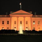 The White House is bathed in orange light on Halloween night in Washington. <span class=
