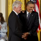 Two US Presidents share a laugh in the White House. <span class=