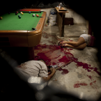 Bodies lie on the floor of a pool hall, after an attack by unidentified masked assailants, in Choloma, on the outskirts of San Pedro Sula, Honduras. <span class=