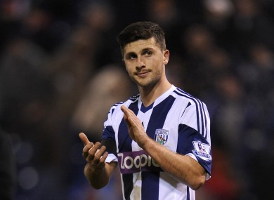 Long applauds the West Brom fans on Monday night.