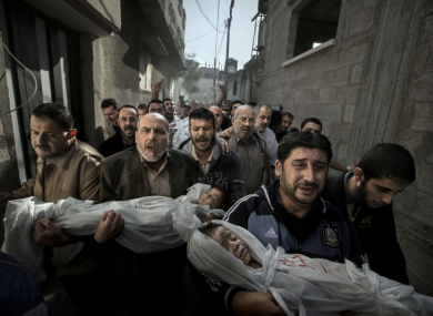 The bodies of two-year-old Suhaib Hijazi and his elder brother Muhammad, almost four, are carried by their uncles to a mosque for their funeral in Gaza City - the winner of the 2013 World Press Photo contest by Sweden's Paul Hansen