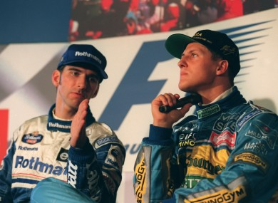 Damon Hill and Michael Schumacher tersely discuss tactics in 1995.