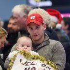 eter Troute waits with his nephew Kevin Byrne (8 months) for Kevin's uncle John<span class=