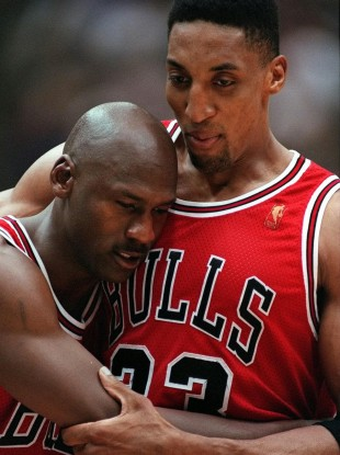 Chicago Bulls Scottie Pippen, right, embraces an exhausted Michael Jordan following their 90-88 win in Game 5 of the NBA Finals against the Utah Jazz, in Salt Lake City.
