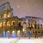 A rare snow shower falls on Rome's Colosseum, built 2,000 years ago to host gladiator duels, battle reenactments, and other public spectacles. Today the 50,000-seat amphitheater serves Rome in another capacity: as a major tourist attraction.<span class=