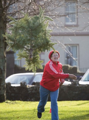 Cllr Patricia McCarthy taking part in the annual Christmas Tree throwing Championships in Ennis yesterday.