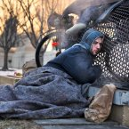 Nick warms himself on a steam grate with three other homeless men by the Federal Trade Commission, just blocks from the Capitol, in Washington<span class=