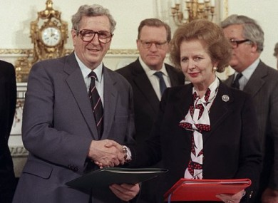 Taoiseach Garret FitzGerald shakes the hand of Britain's Prime Minister Margaret Thatcher after signing the Anglo-Irish agreement.