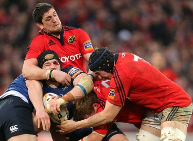 Tommy O'Donnel (right) and James Downey of Munster tackle Leinster's Sean O'Brien.