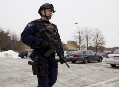 Police move in from a parking lot to the Mall in Columbia after reports of the shooting