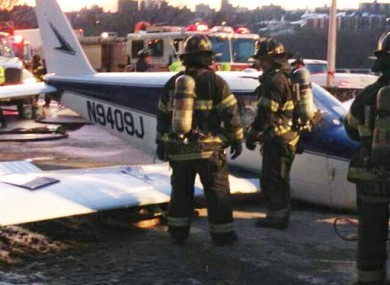 FDNY workers inspect the plane.