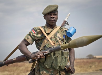 A South Sudanese government soldier stands guard as a delegation of visiting officials leaves from the airport in Malakal, Upper Nile State, in South Sudan