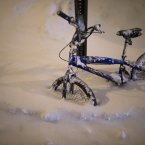 A bicycle is buried by overnight snowfall in the Queens borough of New York. New York City public schools were closed after up to 7 inches of snow fell by morning in the first snowstorm of the winter. <span class=