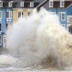 Waves crash against the Aberystwyth coastline. <span class=