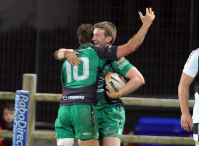 London Irish-bound Eoin Griffin celebrates his try with Dan Parks.