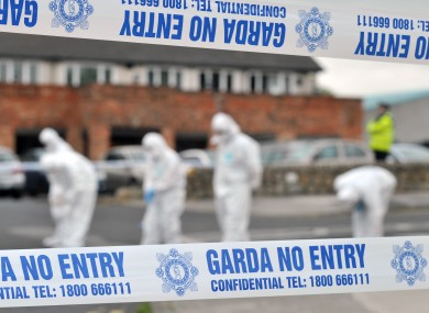 Gardaí at the scene of the shooting at St Dominic's Shopping Centre last year