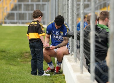 Galvin signs an autograph for one of his young fans, Ryan Neeson.
