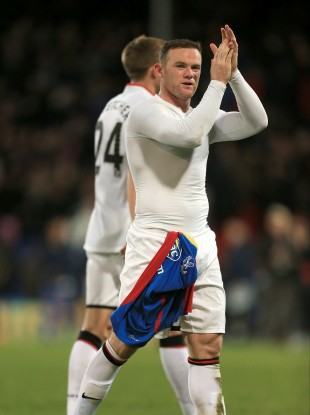 Manchester United's Wayne Rooney applauds the fans after the game.