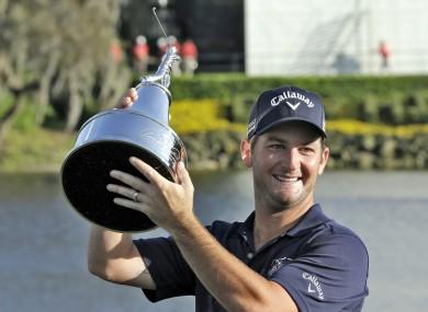 Matt Every lifts the trophy.