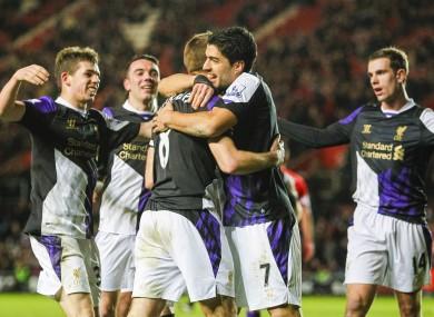 Liverpool's Steven Gerrard (left) celebrates scoring his penalty with team-mate Luis Suarez.