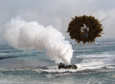 A South Korean marine LVT-7 landing craft sail to shores through a smoke screen during the U.S.-South Korea joint landing exercises called Ssangyong, part of the Foal Eagle military exercises, in Pohang, South Korea.