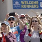 Spectators cheer as the fourth wave of runners started the 118th Boston Marathon<span class=