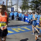 Runner Ryan Hall stands near the start<span class=