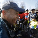 Massachusetts Gov. Deval Patrick greets runners in the mobility impaired division of the 118th Boston Marathon<span class=