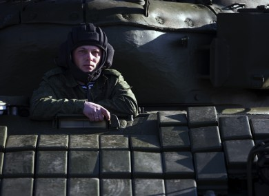 A Russian solder sits in the tank T-72B at the Ostryakovo railway station not far from Simferopol, Crimea.