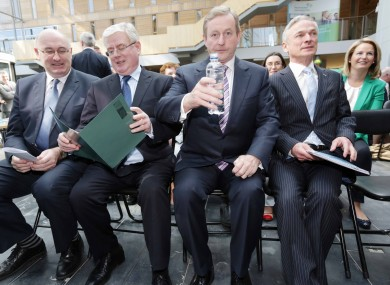 Enda Kenny with a timely bottle of water and flanked by Phil Hogan, Eamon Gilmore and Richard Burton in Mullingar today