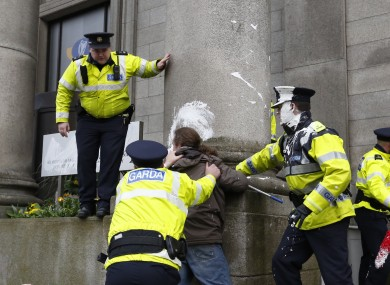 Gardaí and protesters outside the Department of Justice