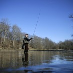 Rob Irving stands in a small lake as he casts while fly-fishing in Tyler State Park near Newtown, Pa. (AP Photo/Mel Evans)<span class=