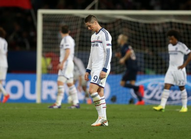 Chelsea's Fernando Torres stands dejected after seeing his side concede their third goal against PSG.