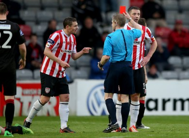 Referee Anthony Buttimer red card's Rory Patterson of Derry as Danny Ventre (l) complains.