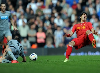 Liverpool's Luis Suarez is fouled by Newcastle United's Paul Dummett during their Premier League match.