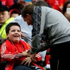 Young Liverpool fan Conor Byrne meets manager Brendan Rodgers.<span class=