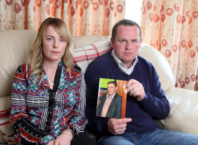 Niamh and John Byrne with an image of their late brother Keith.