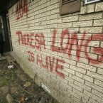 Theresa Long walks into her storm-damaged home in Mayflower, Arkansas, Tuesday, April 29, 2014. Long painted a sign reading